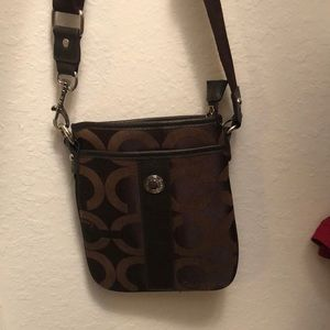 NWOT Coach crossbody bag with dust bag. Never used